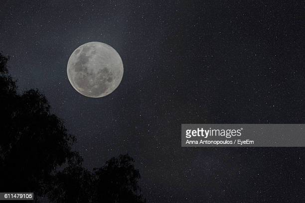 Low Angle View Of Moon Against Star Field At Night