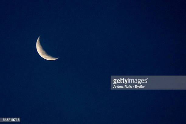 Low Angle View Of Moon Against The Clear Blue Sky