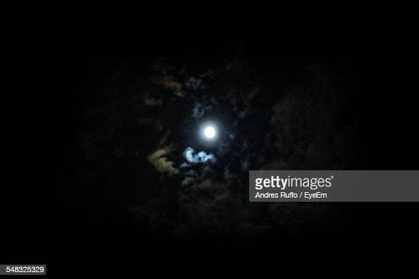 low angle view of moon glowing at night - andres ruffo stock pictures, royalty-free photos & images