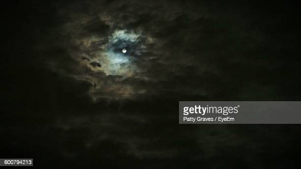 Low Angle View Of Moon In Cloudy Sky At Night
