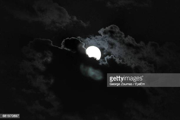 Low Angle View Of Moon In Cloudy Sky