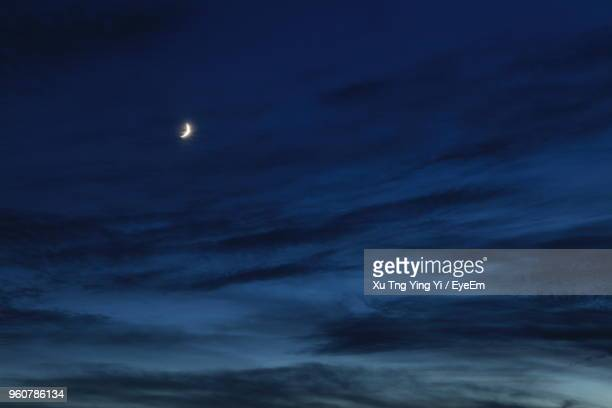 low angle view of moon in sky at night - moonlight stock pictures, royalty-free photos & images