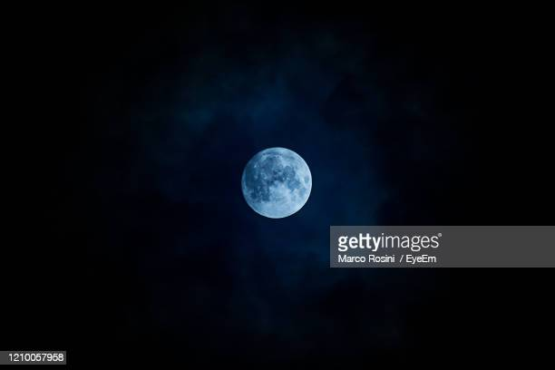 low angle view of moon in sky - midnight stock pictures, royalty-free photos & images