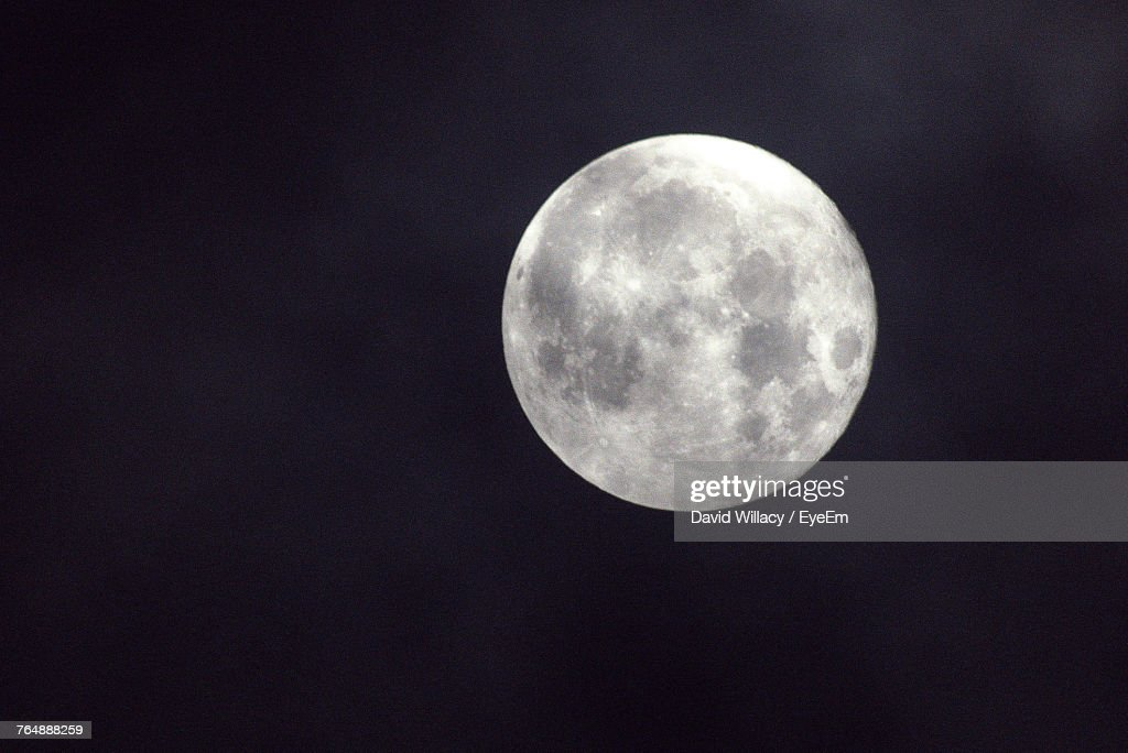 Low Angle View Of Moon In Sky : Stock Photo