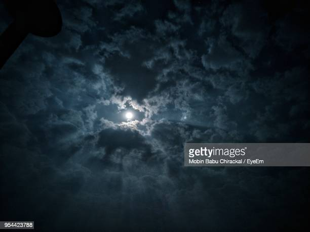 low angle view of moon in sky - moonlight stock pictures, royalty-free photos & images