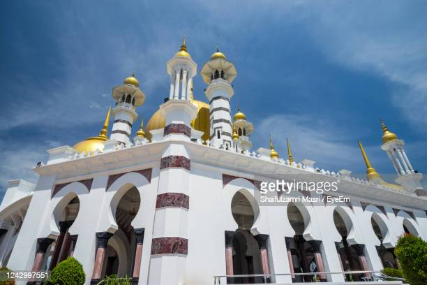 low angle view of mosque against blue sky - shaifulzamri stock pictures, royalty-free photos & images