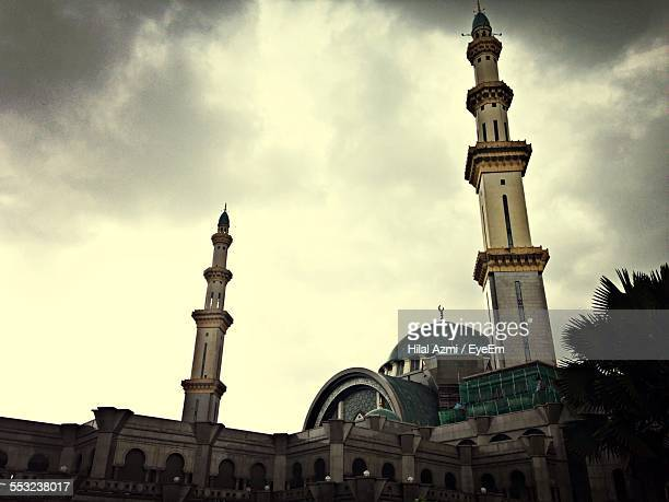low angle view of mosque against cloudy sky at dusk - hilal stock photos and pictures