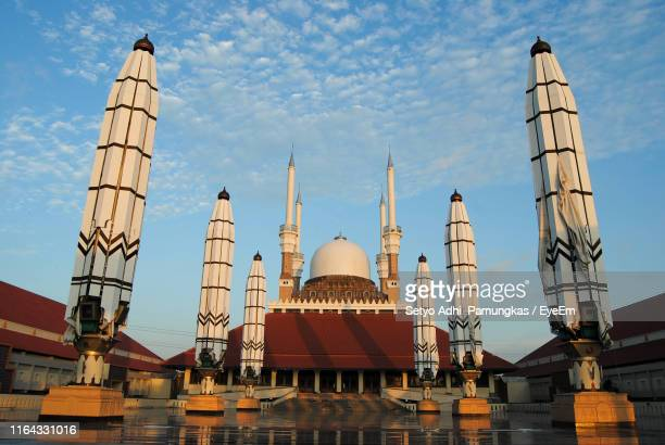 low angle view of mosque against sky in city - mosque stock pictures, royalty-free photos & images