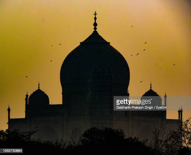 low angle view of mosque against sky - mosque stock pictures, royalty-free photos & images