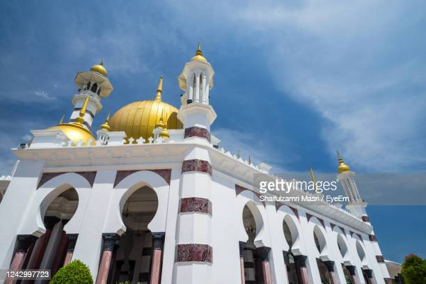 low angle view of mosque against sky - shaifulzamri stock pictures, royalty-free photos & images
