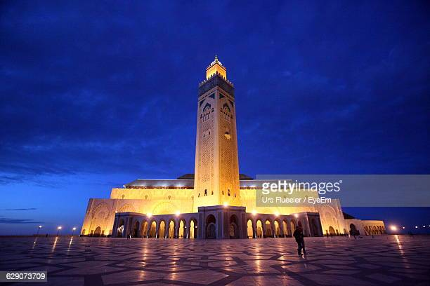 Low Angle View Of Mosque Hassan Ii Against Cloudy Sky In City At Dusk