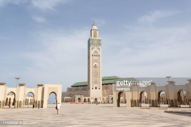 low angle view of mosque hassan ii in casablanca, morocco - casablanca photos et images de collection