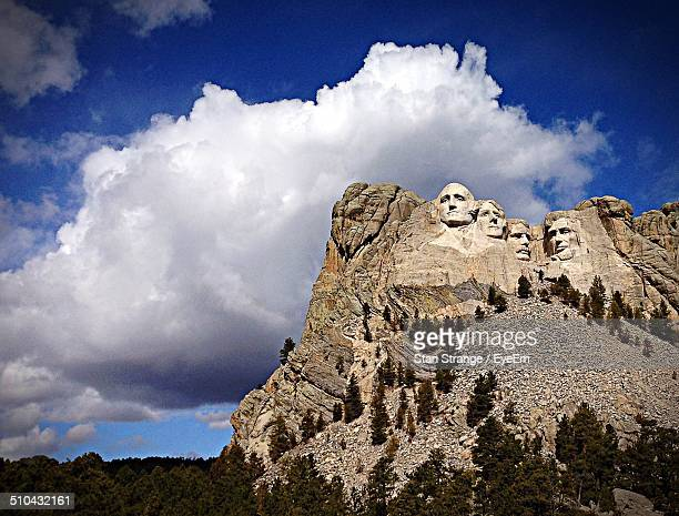 Low angle view of Mount Rushmore against clouds