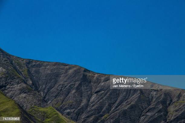low angle view of mountain against clear blue sky - mertens stock pictures, royalty-free photos & images