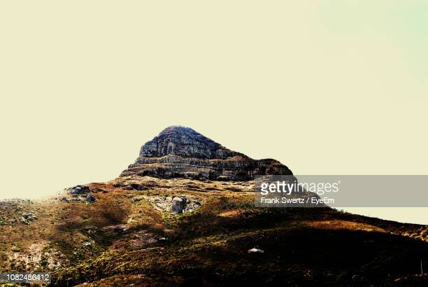 low angle view of mountain against clear sky - frank swertz stock pictures, royalty-free photos & images