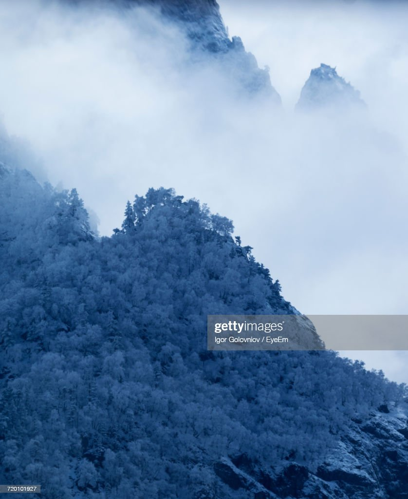 Low Angle View Of Mountain Against Cloudy Sky : Stock Photo