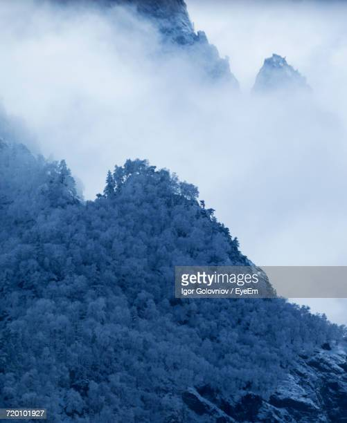 low angle view of mountain against cloudy sky - igor golovniov stock pictures, royalty-free photos & images