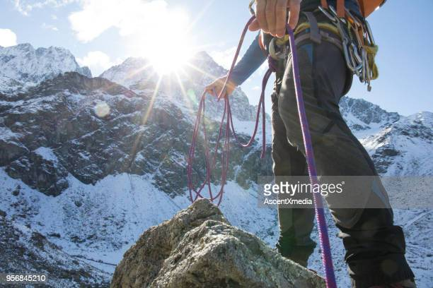low angle view of mountain climber with rope in mountains - beginnings stock pictures, royalty-free photos & images