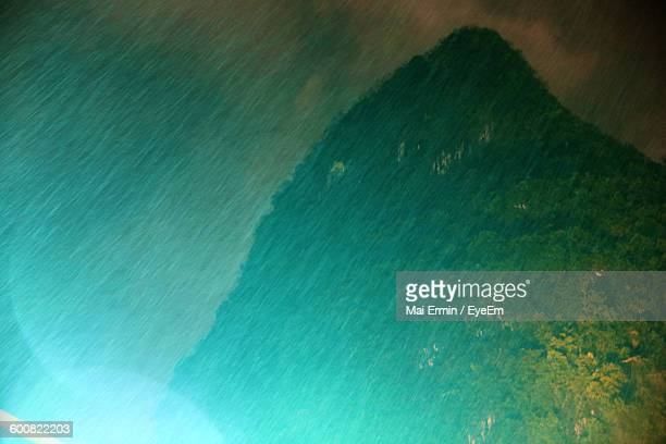 Low Angle View Of Mountain During Rainfall At Night