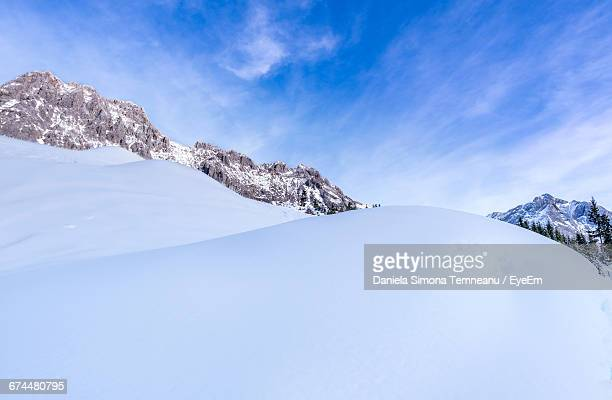 Low Angle View Of Mountain In Snow Covered Landscape