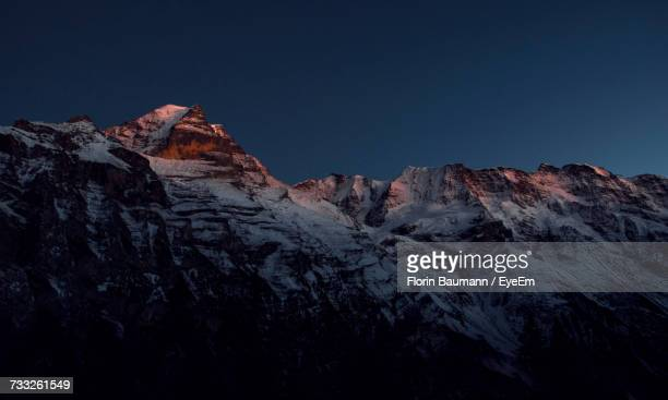 low angle view of mountains against clear sky - snow moon stock pictures, royalty-free photos & images
