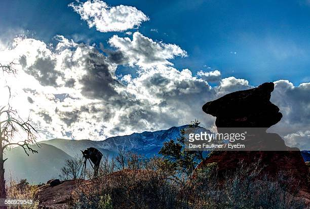 low angle view of mountains against cloudy blue sky - dave faulkner eye em stock pictures, royalty-free photos & images