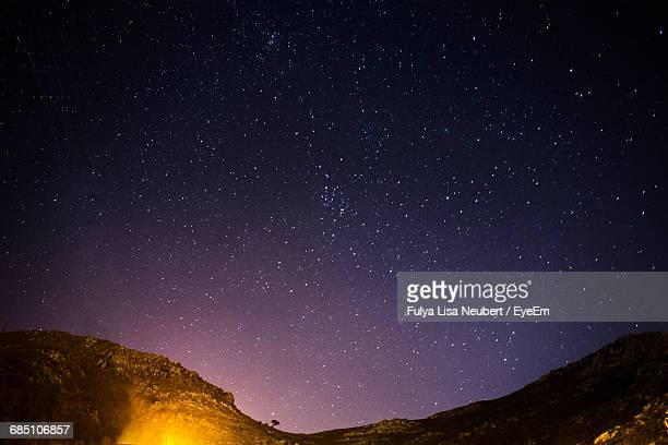 Low Angle View Of Mountains Against Star Field At Night