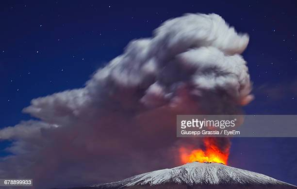 Low Angle View Of Mt Etna Against Sky At Night