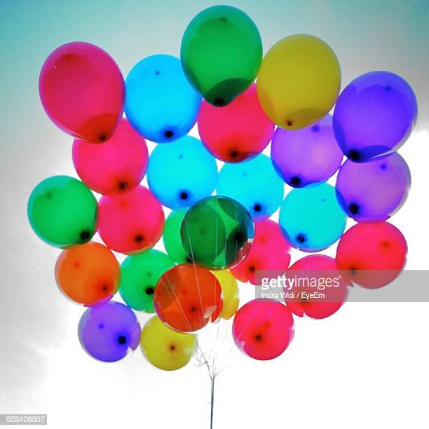 Low Angle View Of Multi Colored Balloons Against Sky