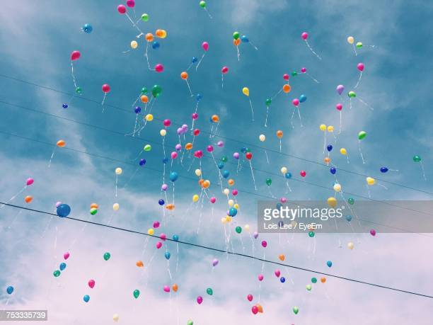 low angle view of multi colored balloons - releasing stock photos and pictures
