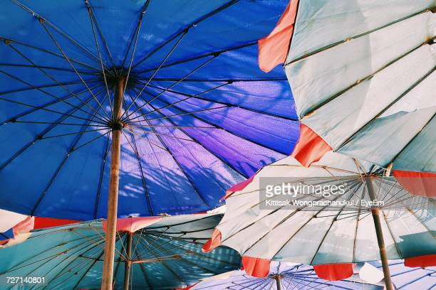 Low Angle View Of Multi Colored Beach Umbrellas