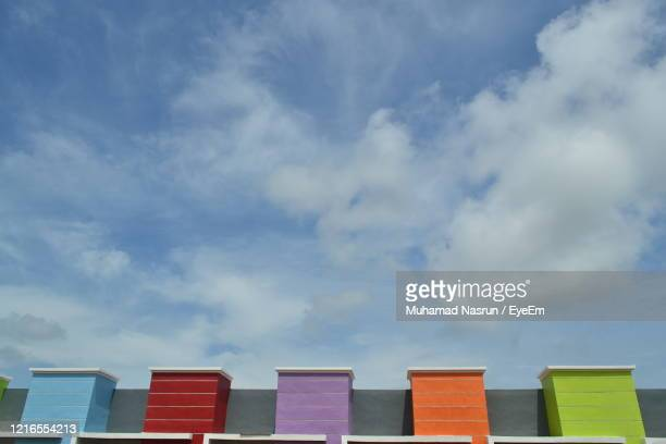 low angle view of multi colored building against sky - muhamad nasrun stock pictures, royalty-free photos & images