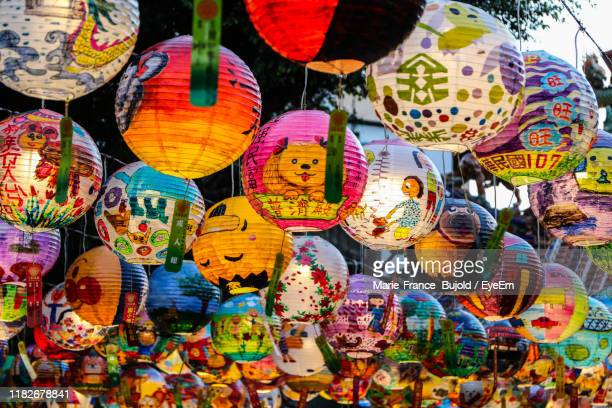 low angle view of multi colored lanterns hanging in market - lantern festival stock pictures, royalty-free photos & images