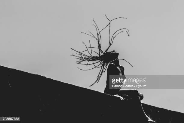 Low Angle View Of Naked Woman Tossing Hair