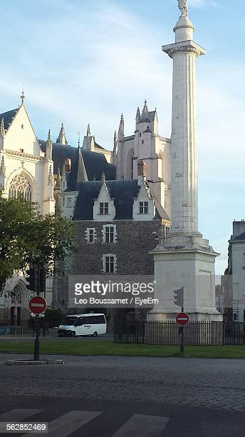 low angle view of nantes cathedral by column against sky at city - kathedrale von nantes stock-fotos und bilder