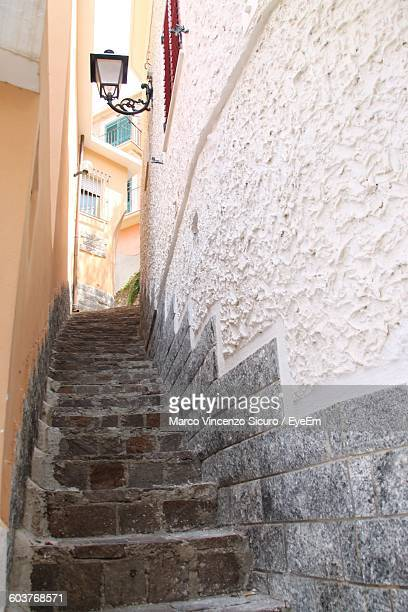 Low Angle View Of Narrow Staircase Amidst Buildings