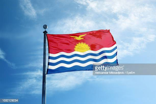 Low Angle View Of National Flag Against Blue Sky