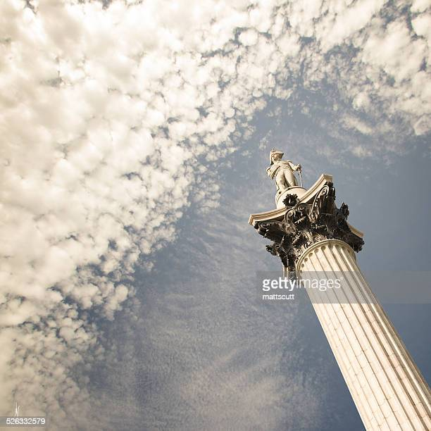 low angle view of nelson's column, england, uk - nelson's column stock photos and pictures