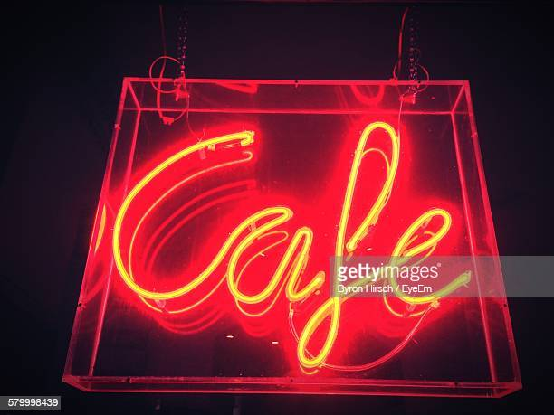 Low Angle View Of Neon Cafe Sign At Night