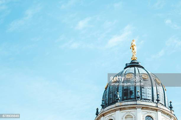 low angle view of neue kirche against sky in city - kirche ストックフォトと画像