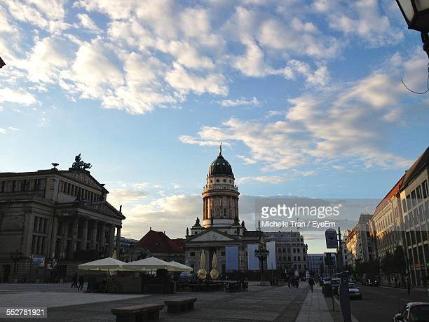 low angle view of neue kirche and buildings against sky - gendarmenmarkt stock pictures, royalty-free photos & images