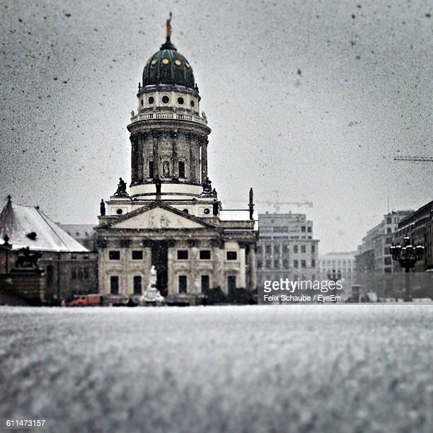 low angle view of neue kirche by street against sky during winter - gendarmenmarkt stock pictures, royalty-free photos & images
