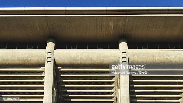 low angle view of nissan stadium against sky - nissan stock pictures, royalty-free photos & images