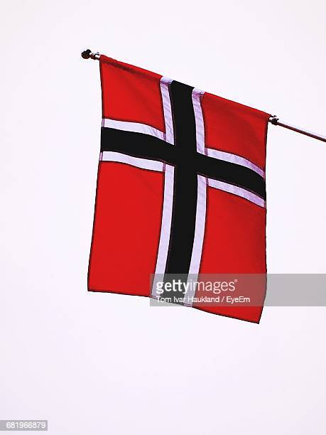 Low Angle View Of Norwegian Flag Against Clear Sky