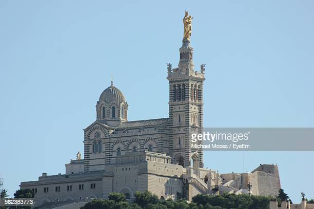 low angle view of notre-dame de la garde against clear blue sky - ポン・デュ・ガール ストックフォトと画像
