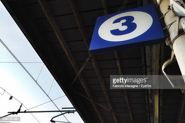 low angle view of number 3 sign at railway station - number 3 stock pictures, royalty-free photos & images