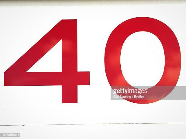 low angle view of number on white wall - number 40 stock photos and pictures