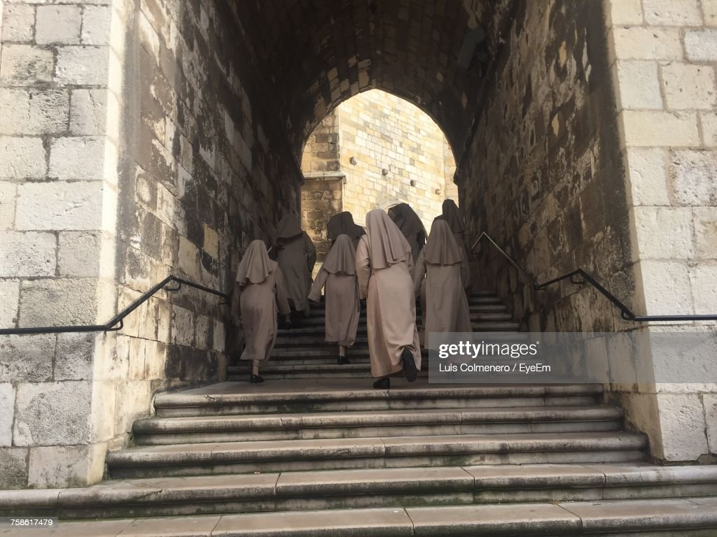 Low Angle View Of Nuns Walking Up Stairs : Foto de stock