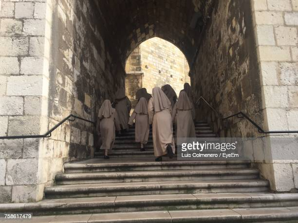 low angle view of nuns walking up stairs - bonne soeur photos et images de collection
