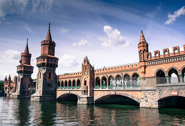 Low Angle View Of Oberbaum Bridge Over River Against Sky